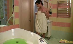 Sexy lesbo dominates sweetheart in bathtub sex tool fucking