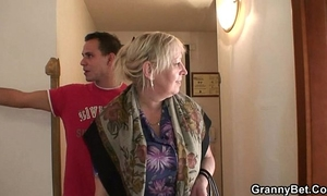 Busty granny is picked up by youthful man